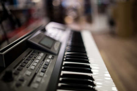 depth of field keyboards keys at the music store Standard-Bild - 127675891