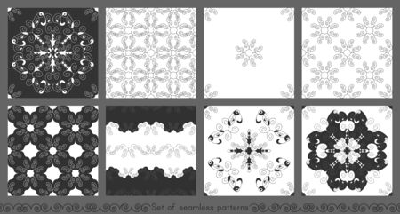 Set of seamless patterns with spirals. Gray, dark gray and white. Vector.