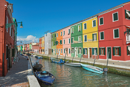 the little venice: Panoramic view of colorful buildings and boats in front of the canal, in a sunny day at Burano, a gracious little town full of canals, near Venice. Located in the Veneto region, northern Italy