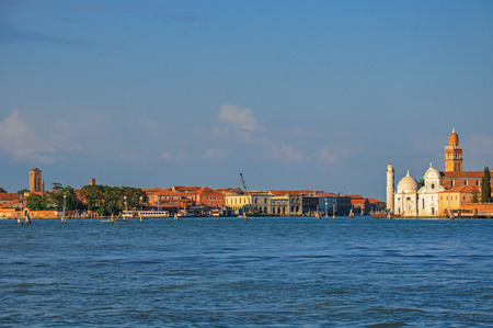 venice: Panoramic view of Venice lagoon with buildings on the horizon, at sunset in the city center of Venice, the historic and amazing marine city. Located in the Veneto region, northern Italy