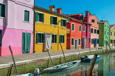 shutter: Burano, Italy - May 08, 2013. Panoramic view of colorful buildings and boats in front of the canal at Burano, a gracious little town full of canals, near Venice. In the Veneto region, northern Italy Editorial