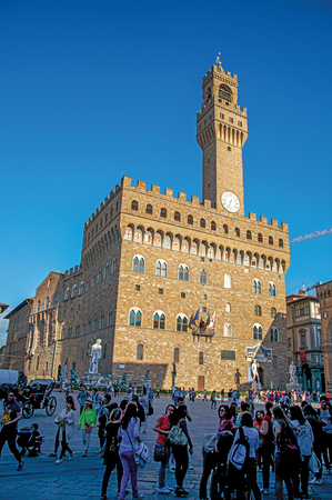 Florence, Italy - May 14, 2013. View of Piazza della Signoria with the Palazzo Vecchio and its tower in the city of Florence, the famous and amazing capital of the Italian Renaissance. Tuscany region