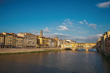 Overview of the river Arno, buildings and the Ponte Vecchio (bridge) at sunset. In the city of Florence, the famous and amazing capital of the Italian Renaissance. Located in the Tuscany region