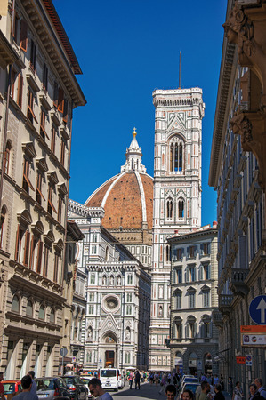 Florence, Italy - May 14, 2013. Street view with the Santa Maria del Fiore Cathedral and Giottos Campanile (bell tower). In Florence, the famous capital of the Italian Renaissance. Tuscany region