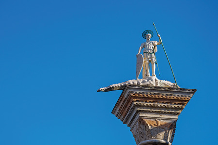 Close-up of St. Theodores Column in St. Marks Square with blue sunny sky. At the city of Venice, the historic and amazing marine city. Located in Veneto region, northern Italy Stock Photo