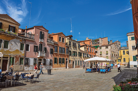 balcony: Venice, Italy - May 09, 2013. Square view of colorful old buildings, restaurants and people. At the city center of Venice, the historic and amazing marine city. Veneto region, northern Italy