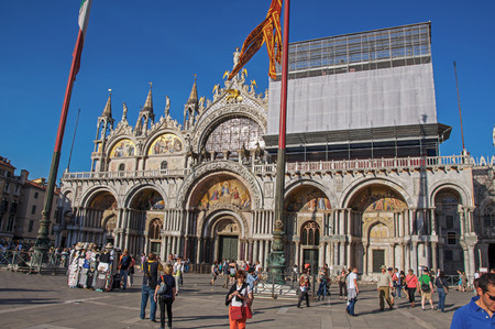venice: View of San Marco Basilica with marble sculptures and golden mosaics in Piazza San Marco. At the city center of Venice, the historic and amazing marine city. Veneto region