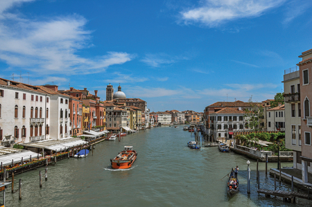 shutter: View of the Grand Canal with boats and buildings on the bank, at the city center of Venice, the historic and amazing marine city. Located in Veneto region, northern Italy