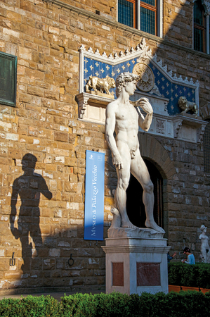 Florence, Italy - May 14, 2013. Close-up of the statue of David in front of the Palazzo Vecchio at sunset in Florence, the famous and amazing capital of the Italian Renaissance. Tuscany region Editorial