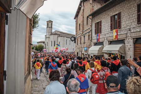 historical events: Gubbio, Italy - May 15, 2013. Colorful crowd participating in the Feast of Ceri, a traditional event of the city of Gubbio, a well preserved medieval town. Located in Umbria region, central Italy