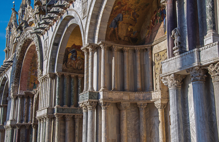 Venice, Italy - May 08, 2013. Close-up of columns, arches made of various types of marble on the San Marco Basilica facade. At the city of Venice, the historic and amazing marine city. Veneto region