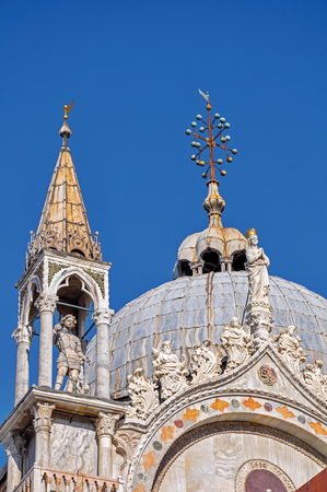 venice: Close-up of marble sculptures and dome in typical Venetian style on the San Marco Basilica. At the city of Venice, the historic and amazing marine city. Located in Veneto region, northern Italy Stock Photo