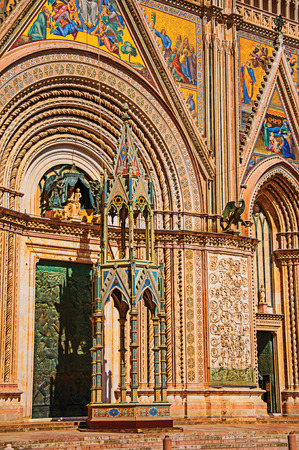 Facade details of the opulent and monumental Orvieto Cathedral (Duomo) on a sunny day in Orvieto, a pleasant and well preserved medieval town. Located in Umbria, central Italy. Retouched photo Stock Photo