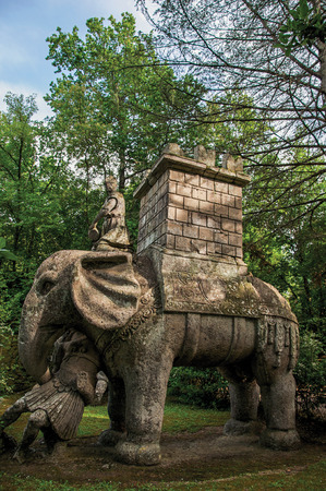 View of sculpture amidst the vegetation in the Park of Bomarzo. Also known as Park of Monsters, it was created to surprise the visitor with surrealistic works in stone. Lazio region, central Italy