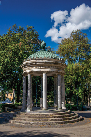 Close-up of small temple and trees at Villa Borghese in Rome, the incredible city of the Ancient Era, known as The Eternal City. Located in the Lazio region, central Italy