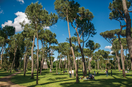 Rome, Italy - May 19, 2013. View of people in park of Villa Borghese on a sunny day in Rome, the incredible city of the Ancient Era, known as The Eternal City. Lazio region, central Italy Editorial