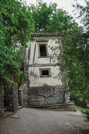 View of house amidst the vegetation in the Park of Bomarzo. Also known as Park of Monsters, it was created to surprise the visitor with surrealistic works in stone. Lazio region, central Italy Stock Photo