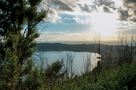 maleza: View of the slopes, forests and hills of Lake Albano in a cloudy sunset. Albano is a quiet and bucolic countryside region near Rome. Located in the Lazio region, central Italy