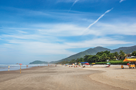 bather: View of sand, sea, forest on the hill and people in a sunny sunny day at the beach of Juquey, an amazing and tropical village in the coast of the Sao Paulo State, southwestern Brazil. Stock Photo