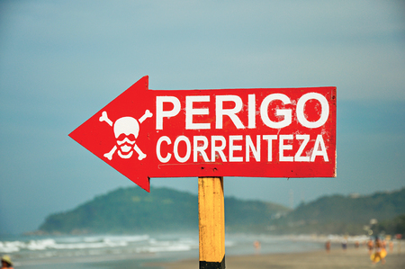 bather: Close-up of warning sign where it is written in Portuguese