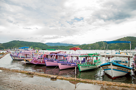 ship anchor: Paraty, Brazil - January 22, 2015. View of colorful boats in rainy day anchored in Paraty, an amazing and historic town totally preserved in the coast of Rio de Janeiro State, southwestern Brazil