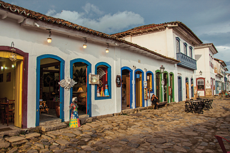 Paraty, Brazil - January 22, 2015. View of shops in old houses and cobblestone at sunset in Paraty, an amazing and historic town totally preserved in Rio de Janeiro State coast, southwestern Brazil