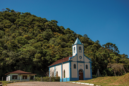 Visconde de Maua, Brazil - January 19, 2015. View of small church with belfry and forest in Visconde de Maua, a village in the middle of mountains an trees. Rio de Janeiro State, southwestern Brazil