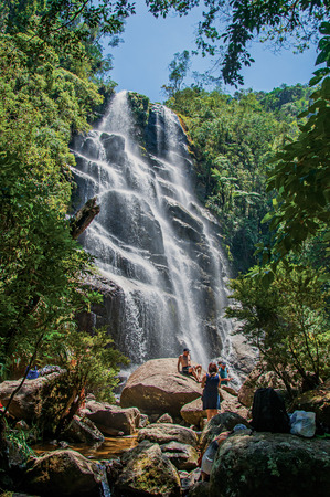 bather: Itatiaia, Brazil - January 20, 2015. View of waterfall and people in Itatiaia Park, an altitude park, known for its wildlife, trails and forests. Rio de Janeiro State, southwestern Brazil Editorial