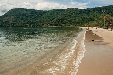 bather: View of beach, sea and forest on cloudy day in Paraty Mirim, a tropical beach near Paraty, an amazing and historic town totally preserved in the coast of Rio de Janeiro State, southwestern Brazil. Stock Photo