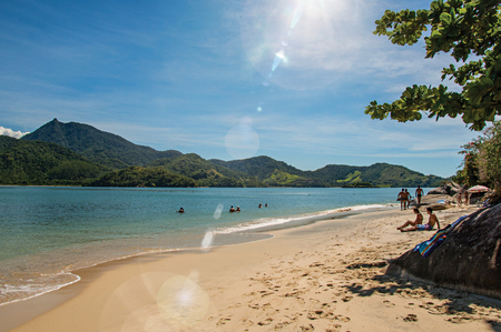 Paraty, Brazil - January 25, 2015. View of beach, sea and forest on sunny day in Pelado Island, a tropical beach near Paraty, an amazing and historic town in the Rio de Janeiro State. Retouched photo Editorial