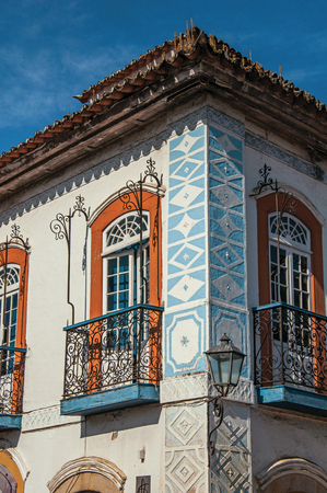 balcony: Close-up of cobblestone street with old houses under blue sunny sky in Paraty, an amazing and historic town totally preserved in the coast of Rio de Janeiro State, southwestern Brazil