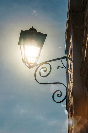 View of street lamp with sunlight and clear sky in Paraty, an amazing and historic town totally preserved in the coast of Rio de Janeiro State, southwestern Brazil. Retouched photo