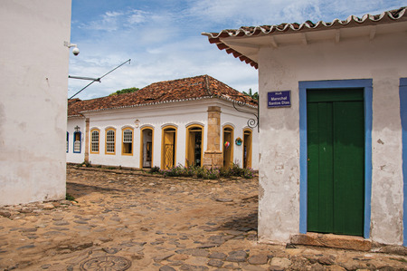 street lamp: Paraty, Brazil - January 26, 2015. View of cobblestone alley with old colorful houses and vegetation in Paraty, an amazing and historic town totally preserved in the coast of Rio de Janeiro State