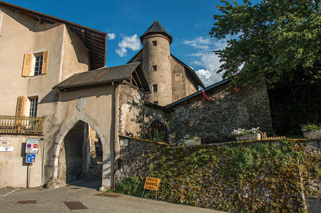 Stone arch at the entrance of Conflans. An historical hamlet near Albertville. Located in the department of Haute-Savoie, south-eastern France. Retouched photo.