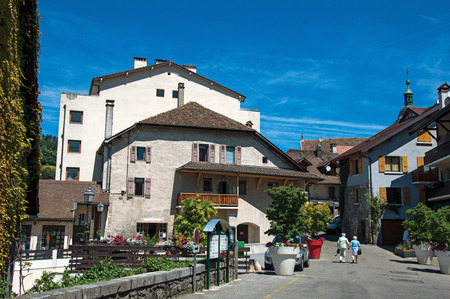 Talloires, France - June 29, 2016. View of street and houses in the village of Talloires, near the Lake of Annecy. Department of Haute-Savoie, Auvergne-Rhone-Alpes region, south-eastern France.