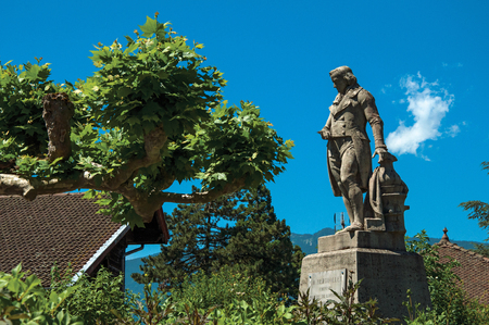 Talloires, France - June 29, 2016. Statue with trees in the lovely village of Talloires, near the Lake of Annecy. Department of Haute-Savoie, Auvergne-Rhone-Alpes region, south-eastern France.