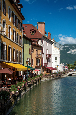 Annecy, France - June 30, 2016. Facade of old and colorful buildings facing the canal, in Annecy. An historical and lovely lakeside town located in the department of Haute-Savoie, south-eastern France Editorial