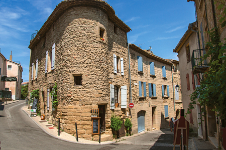 Chateauneuf-du-Pape, France, July 02, 2016. Street view with stone houses in the center of Chateauneuf-du-Pape hamlet, near Avignon. Vaucluse department, Provence region, southeastern France