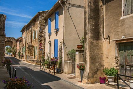 Chateauneuf-du-Pape, France, July 02, 2016. Street view with stone houses in the city center of Chateauneuf-du-Pape hamlet. Near Avignon, Vaucluse department, Provence region, southeastern France