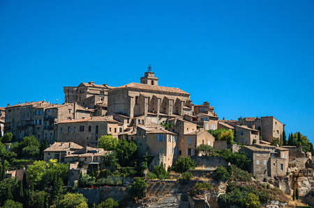 Close-up of the village of Gordes on top of a hill and under sunny blue sky. Located in the Vaucluse department, Provence region, in southeastern France Stock Photo