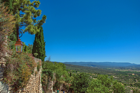 View of the fields and hills of Provence near Gordes, under sunny blue sky. Located in the Vaucluse department, Provence region, southeastern France Stock Photo