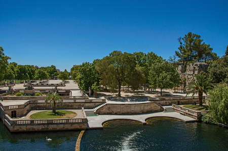 Panoramic of the 18th-century Gardens of the Fountain, built around the Roman thermae ruins, in the city center of Nimes. Located in the Gard department, Occitanie region in southern France