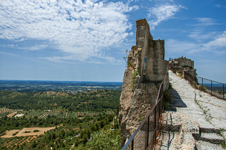 Panoramic view of the castle of Baux-de-Provence at the top of the hill, with the fields and hills of Provence just below. Bouches-du-Rhone department, Provence region, southeastern France Stock Photo