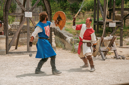 Baux-de-Provence, France - July 05, 2016. Actors doing theatrical staging of the medieval fighters in the castle of Baux-de-Provence. Bouches-du-Rhone department, Provence region, southeastern France
