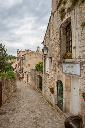 Baux-de-Provence, France - July 05, 2016. Ancient stone houses in alley, in the medieval hamlet of Baux-de-Provence. Bouches-du-Rhone department, Provence-Alpes-C?te d'Azur region, southeastern France