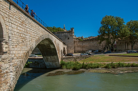 View of the Arches of the Pont dAvignon (bridge), with the historic center of the charming Avignon in the background. Vaucluse department, Provence-Alpes-Côte dAzur region, southeastern France
