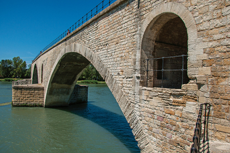 View of the Arcs of the Pont dAvignon (bridge) under a sunny blue sky, city of Avignon. Located in the Vaucluse department, Provence-Alpes-Côte dAzur region, southeastern France
