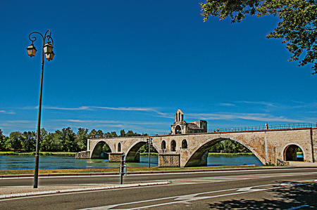 Panoramic view of the Pont dAvignon (bridge) and the Rhone River, in the sunny city of Avignon. Vaucluse department, Provence-Alpes-Côte dAzur region, southeastern France. Retouched photo