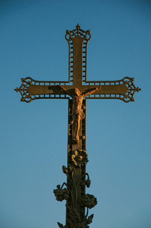 Close-up of cross with blue sky at sunset, in the city center of Chateauneuf-de-Gadagne. Located in the Vaucluse department, Provence-Alpes-Côte dAzur region, southeastern France