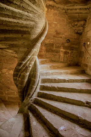 Lourmarin, France - July 07, 2016. View of stone staircase with playful light at Lourmarin castle, near the lovely village of Lourmarin. Vaucluse department, Provence region, southeastern France